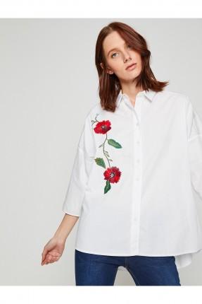 قميص نسائي بنقشة وردة على الجانب