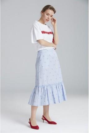 تنورة طويلة مع كشكش مزهرة
