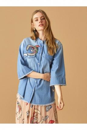 قميص نسائي جينز بجيوب جانبية مطرز سبور