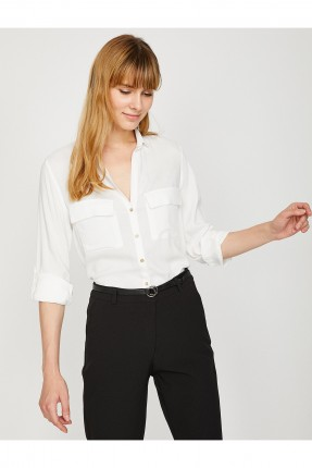 قميص نسائي بجيوب جانبية سبور شيك