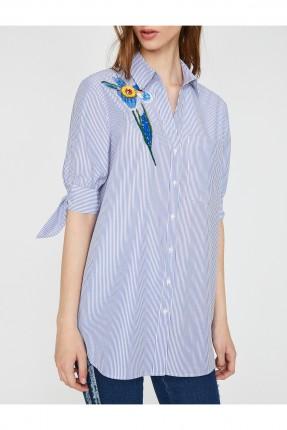 قميص نسائي مقلم بجيب جانبي مزين وردة من الجانب