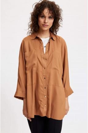 قميص نسائي بجيوب امامية