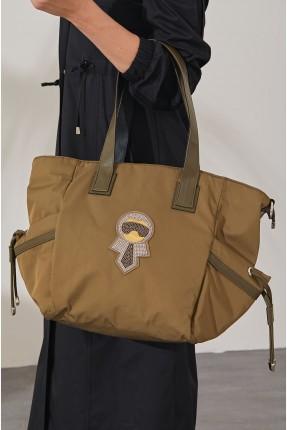 حقيبة يد نسائية بربطات على الجوانب