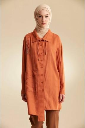 قميص نسائي بازرار سادة اللون