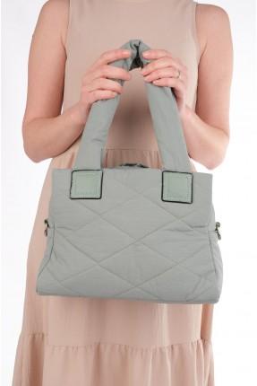 حقيبة يد نسائية مزينة بحبكة