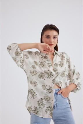 قميص نسائي مزين بزم عند الاكمام