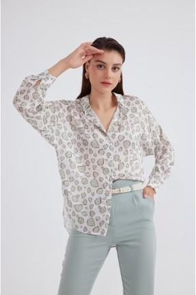 قميص نسائي مزين بازرار
