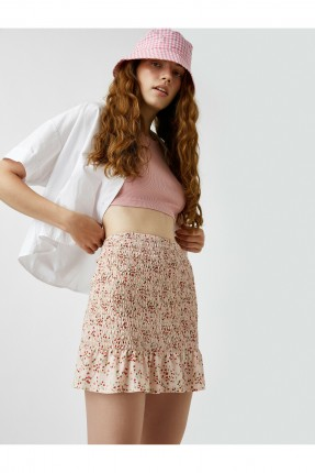 تنورة قصيرة مزينة بمطاط